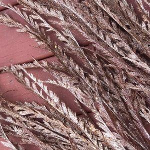 Artificial glittery grass stems.